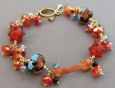 Hot red bling dog lover bracelet. Chubby crystals with artisan lampwork beads. Copper dog bone focal.  Inspired by the bracelet For Love of a Dog designed for Rachael Ray.