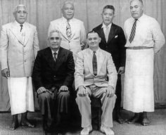 Back left: Tofaeono, Tualaulelei Mauri, Tu'u, Afamasaga Kalapu. Front Left: Hon Fonoti Mata'utia Ioane Brown and Mr Fred Betham. Govt trip to NZ to bring the Mace for the Parliament House of Samoa In 1955. Mace: Symbol of the United Kingdom of British partnership of the Queen in Parliament House of Samoa.