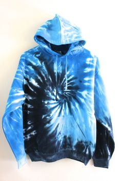 Navy blue, medium blue and light blue ocean inspired tie-dye, 80% cotton/20% polyester sweatshirt hoodie with adjustable drawstrings, and a front pocket. Please note: Each tie-dyed hoodie is hand dyed