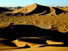 Late afternoon light creates shadows among the dunes and ripples of this desert region, James L. stanfield