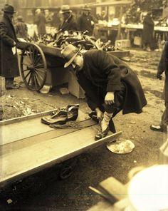 Shoe vendor on Maxwell Street, Chicago, 1930.