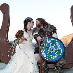Viking Wedding--I love the feathers in her bouquet
