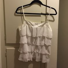 Top by My Michelle Pretty off white ruffled, silky top by My Michelle. Size Large. Great condition. Perfect for layering! My Michelle Tops Camisoles