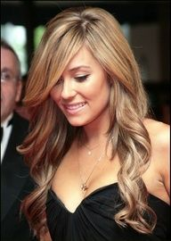 I love the color, cut and style of her hair here.