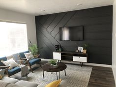I had way to much fun making this accent wall. Check out my blog to see how I did it Feature Wall Living Room, Accent Walls In Living Room, Accent Wall Bedroom, Living Room Tv, Home And Living, Tv Feature Wall, Feature Wall Design, Bedroom Wall Designs, Accent Wall Designs