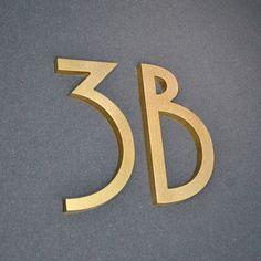 Metal Letters, Letters And Numbers, Door Numbers, Brass Bathroom Fixtures, Cement House, Door Signage, Metal House Numbers, Mcm House, Gold Door