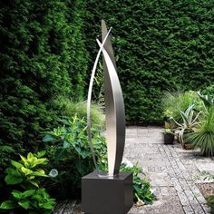 """Flight,"" a sleek, stainless steel outdoor garden sculpture with a bronzed cube plinth. Steel Sculpture, Modern Sculpture, Backyard Garden Design, Garden Art, Outdoor Sculpture, Garden Sculpture, Private Garden, Modern Landscaping, Dream Garden"