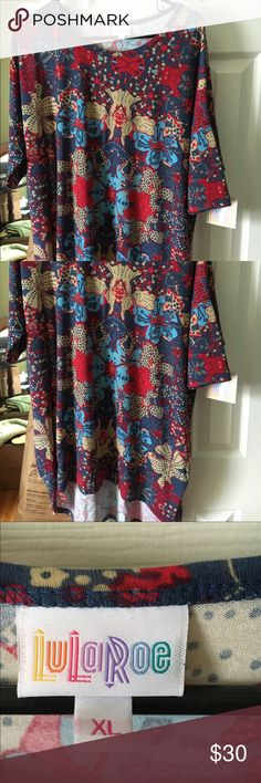 LulaRoe Irma Size XL Tan-toned XL Irma LulaRoe. Antiquish blue, red, tan (colors are not bold, per se) paid 35 + 6 shipping. New with tags. LuLaRoe Tops Tunics