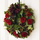 fresh xmas wreath with pine cones