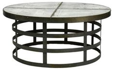 """Recycled-Metal 42"""" Round Coffee Table A striking industrial piece, this dining table has a contemporary edge. Made of recycled metal with exposed rivets and an almost sculptural base, the table is a work of art, as well as a functional piece."""