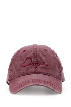 "A baseball cap by Dope™ featuring a vintage wash, a tonal embroidered ""Dope"" script logo, and an adjustable brass back closure."