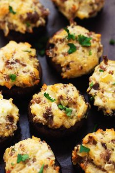 Mushroom caps get stuffed with creamy and delicious mixture of onions, garlic, chopped mushroom stems, and sausage!  These are a ...