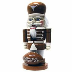 """With Topperscot's Elite Nutcracker, you will get into the holiday spirit while supporting your favorite team! Our decorative 7"""" Nutcracker is made of sturdy painted wood and makes a perfect addition to any collection. The traditional-style nutcracker comes complete with hair and a beard, as well as a working mouth. Team logos are prominently features on the hat and ball with bright team colors over the entire figure. A perfect decoration for any fan!"""