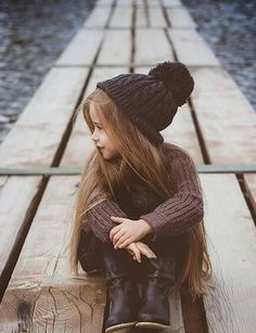 Children's fall style - brown sweater, black boots & a beanie