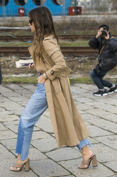 Miroslava Duma wearing Vetements jeans at Milan Fashion Week.