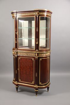 A Late 19th Century Louis XVI Style Gilt Bronze Mounted Parquetry Vitrine Cabinet  By Paul Sormani