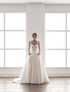 wedding dress in cream with a bustier and a full skirt