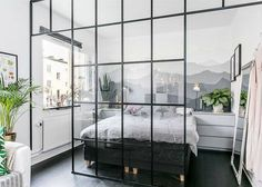 Grid glass divider for a bedroom -- great for small spaces