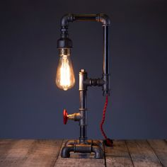Steampunk Pipe Lamp - a handcrafted work of art for the  industrial interior design lovers Industrial Interior Design, Industrial Interiors, Pipe Lamp, Mason Jar Lamp, Light Bulb, Steampunk, Table Lamp, Lovers, Studio