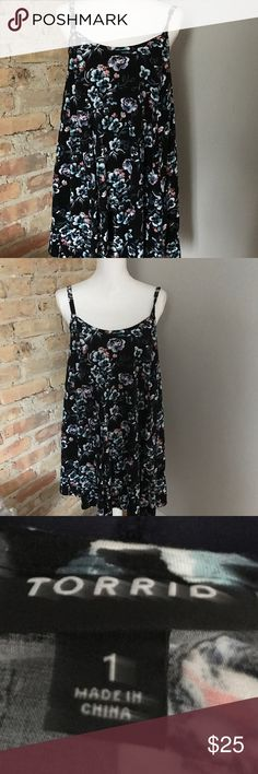 "Torrid a-line floral dress size 1. Torrid a-line dress size 1. Black floral design. Adjustable straps. Bust is 20"" across. Very good condition. Smoke free pet friendly home. torrid Dresses"
