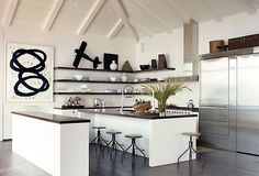 A minimal and modern black and white kitchen.