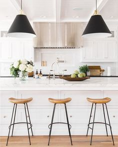 Black, white, and wood. Another home-run from the talented bunch over at @studiomcgee! #dreamhome #kitcheninspo #kitchengoals #brightwhite #modern #farmhouse #kitchen #interiorinspo #interiordesign