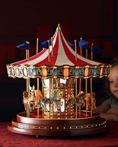 Make this decorative piece a centerpiece to behold and enjoyed by children and adults alike. Created as a special, limited-edition item, celebrating Gold Label's 75th year in business, this collectible carousel music box plays 20 Christmas carols as well as 20 year-round classics while it slowly revolves full circle. It's beautifully crafted and exceptionally detailed …