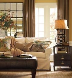 This room looks warm and inviting..I love Pottery Barn!