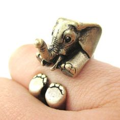 - Details - Sizing An animal inspired ring made in the shape of a baby elephant in brass! Imagine seeing a baby elephant staring up at you every time you glance down at your finger! This super cute ri