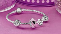 New Mickey Mouse Icon Murano Glass Charm by PANDORA.  If you are visiting Disneyland Resort, stop by La Mascarade d'Orleans in New Orleans Square at Disneyland park or click through the image to purchase on Disneystore.com/pandora.