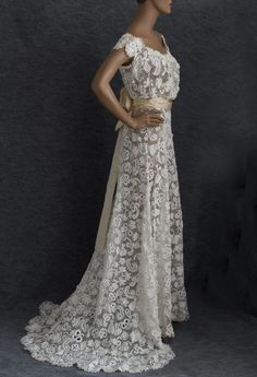 This is a picture of a wedding gown from Vintage Textile Gowns. It was customized for a customer.   How beautifully it came out.  (This has no pattern.  Just picture).