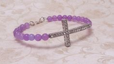 Purple Jade 6mm on Memory Wire, with a lovely Rhinestone Sideways Cross, The bracelet has a silver tone lobster style clasp closure. This would make a beautiful Easter time gift.    Fits up to an 8'' wrist    $18.00