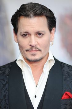 """Johnny Depp Photos - Johnny Depp attends the European premiere of """"Alice Through The Looking Glass"""" at Odeon Leicester Square on May 10, 2016 in London, England. - 'Alice Through The Looking Glass' - European Film Premiere - Red Carpet Arrivals"""