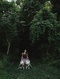 a dress made of flowers. // looks like she is growing straight out of the ground. How magical!