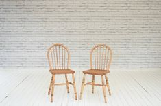 A pair of hoop backed kitchen chairs