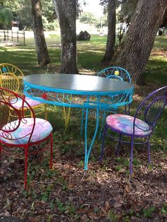 Wrought iron table and chairs I painted different colors.I used an old shower curtain for the seat cushions recovering.