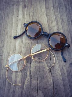 Vintage 1930's black round sunglasses w amber yellow lenses and 1950's round gold tone metal eyeglasses w coil cable temples. Both pairs w non RX lenses suitable for your own RX.