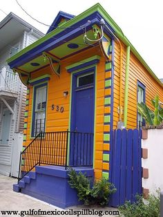 Brightly colored shot gun style house, NOLA architecture, Bywater Neighborhood New Orleans