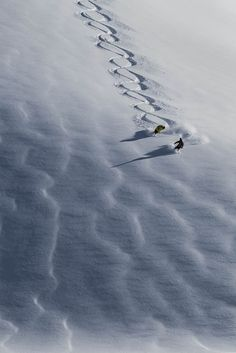 A little figure 8 action to impress our ski guide.   PHOTO: Scott Serfas | Caught Up: Bryan Fox | TransWorld SNOWboarding