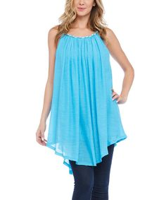 This Turquoise Asymmetrical Sleeveless Tunic is perfect! #zulilyfinds