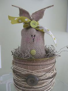 Burlap, twine & wire! Tuck a little spanish moss inside and you are done!