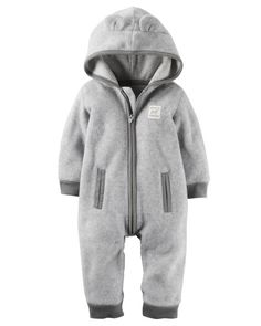 Super soft and cozy, this zip-up fleece jumpsuit keeps him warm from dusk to dawn. Ribbed cuffs, kanga pockets and a hood with 3D ears complete this adorable look.