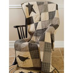 """Kettle Grove Patchwork Quilted Throw Perfect for those extra chilly nights or snuggling on the couch with the family, this Kettle Grove patchwork quilted throw measures 50x60"""". It is made from 100% co"""