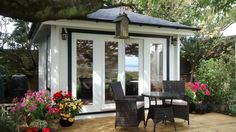A 3.5m square garden room in 58mm log with pyramid roof. www.logcabinsscotland.co.uk