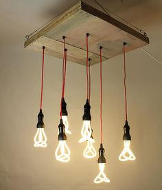 Oh, if only! Lovely Collaboration piece by Racepony Studio and Urban Shandy- Reclaimed wood art canvas by  made into modern hanging light.