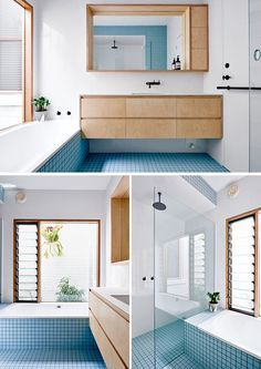 Blue tiles add a pop of colour to the otherwise wood and white bathroom.