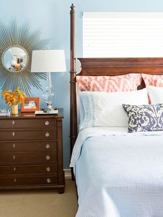 Furniture, bright pillows and shiny accessories pop against a blue backdrop.