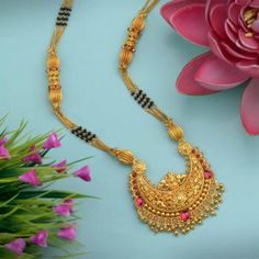 Explore the trendy collection of Gold Mangalsutra design at Waman Hari Pethe Sons. Gold Bangles Design, Gold Jewellery Design, Gold Jewelry, Beaded Jewelry, High Jewelry, Jewlery, Gold Necklace Simple, Long Pearl Necklaces, Egyptian Jewelry