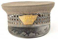 Western Union Uniform cap with badge marked as #277. Cap shows signs of heavy wear with someof the woven middle section broken, and wear to the yellow enamel of the badge. Manufacturer marked Marcus Ruben Uniforms and Linens South State Street Chicago. size: unmarked