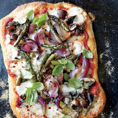 Roasted Asparagus, Mushroom, and Onion Pizza | MyRecipes.com Partially baking the pizza before freezing helps draw moisture out of the vegetables and set the crust so it stays nice and crisp.